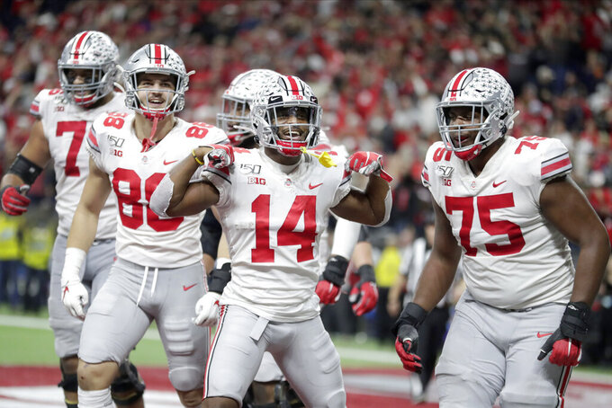 Ohio State wide receiver K.J. Hill (14) celebrates a touchdown during the second half of the Big Ten championship NCAA college football game against Wisconsin, Saturday, Dec. 7, 2019, in Indianapolis. (AP Photo/Michael Conroy)
