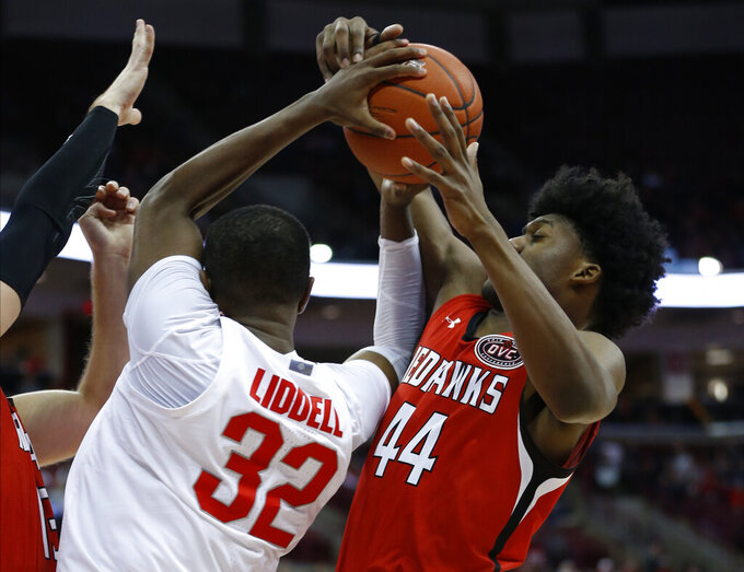 Southeast Missouri State's Darrious Agnew, right, grabs a rebound away from Ohio State's E.J. Liddell during the second half of an NCAA college basketball game Tuesday, Dec. 17, 2019, in Columbus, Ohio. Ohio State defeated Southeast Missouri State 80-48. (AP Photo/Jay LaPrete)