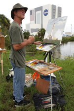 FILE - In this Friday, July 8, 2011 file photo, artist Larry Moore paints the scene at the Kennedy Space Center in Cape Canaveral, Fla., during the launch of the Atlantis, the 135th and final space shuttle mission for U.S. (AP Photo/Robert Ray)