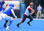 San Diego State quarterback Ryan Agnew (9) scrambles as away from the Boise State defense in the first half of an NCAA college football game, Saturday, Oct. 6, 2018, in Boise, Idaho. (AP Photo/Steve Conner)