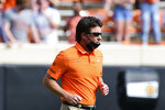 Oklahoma State head coach Mike Gundy jogs onto the field at the start of an NCAA college football game against Tulsa, Saturday, Sept. 19, 2020, in Stillwater, Okla. (AP Photo/Brody Schmidt)