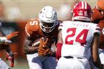 Texas running back Bijan Robinson (5) runs against Louisiana-Lafayette during the first half of an NCAA college football game Saturday, Sept. 4, 2021, in Austin, Texas. (AP Photo/Eric Gay)