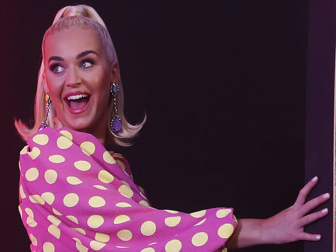 Singer Katy Perry gestures as she leaves after addressing press conference ahead of her performance in Mumbai, India, Tuesday, Nov. 12, 2019. (AP Photo/Rafiq Maqbool)