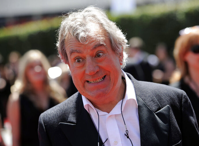 "FILE - In this Saturday, Aug. 21, 2010 file photo, Terry Jones arrives at the Creative Arts Emmy Awards in Los Angeles. Terry Jones, a member of the Monty Python comedy troupe, has died at 77. Jones's agent says he died Tuesday Jan. 21, 2020. In a statement, his family said he died ""after a long, extremely brave but always good humored battle with a rare form of dementia, FTD."" (AP Photo/Chris Pizzello, file)"