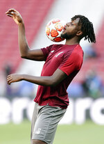 Liverpool forward Divock Origi controls the ball during a training session at the Wanda Metropolitano stadium in Madrid, Friday May 31, 2019. English Premier League teams Liverpool and Tottenham Hotspur are preparing for the Champions League final which takes place in Madrid on Saturday night. (AP Photo/Manu Fernandez)