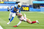 Los Angeles Chargers running back Larry Rountree III, left, is tackled by San Francisco 49ers linebacker Jonas Griffith during the first half of a preseason NFL football game Sunday, Aug. 22, 2021, in Inglewood, Calif. (AP Photo/Jae C. Hong)