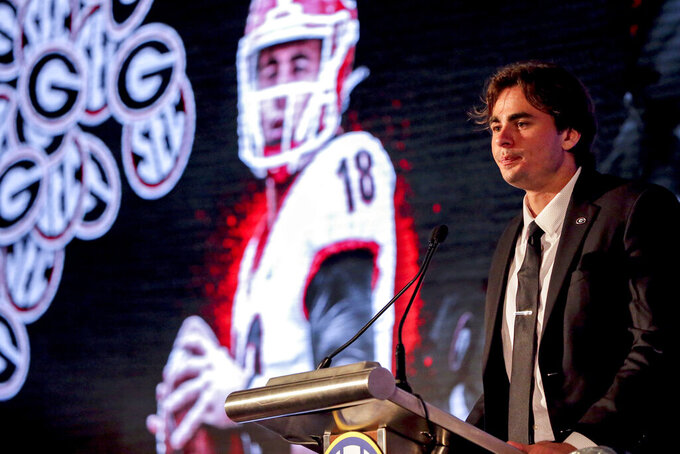 Georgia's JT Daniels speaks to reporters during a Southeastern Conference Media Days NCAA college football news conference, Tuesday, July 20, 2021, in Hoover, Ala. (AP Photo/Butch Dill)