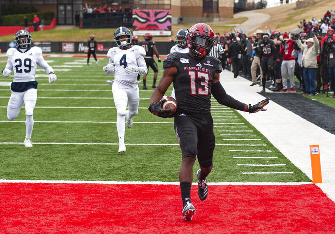Arkansas State wide receiver Kirk Merritt (13) reacts after returning a kickoff 94-yards for a touchdown during the second quarter of an NCAA college football game against Georgia Southern, Saturday, Nov. 23, 2019, at Centennial Bank Stadium in Jonesboro, Ark. (Quentin Winstine/The Jonesboro Sun via AP)