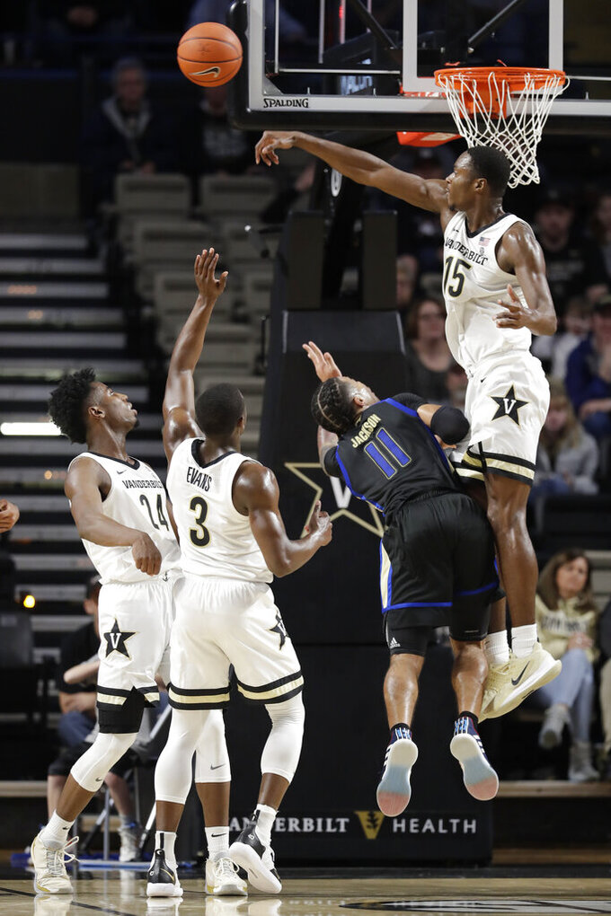 Vanderbilt forward Clevon Brown (15) blocks a shot by Tulsa guard Darien Jackson (11) during the first half of an NCAA college basketball game Saturday, Nov. 30, 2019, in Nashville, Tenn. (AP Photo/Mark Humphrey)