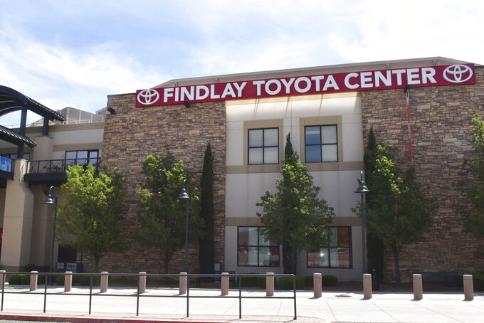 """The exterior of the Findlay Toyota Center is shown in Prescott Valley, Ariz., on May 12, 2020. A multipurpose arena in Prescott Valley will be the latest large venue in Arizona to become a COVID-19 vaccination site. Cottonwood-based Spectrum Healthcare on Monday, Jan. 25, 2021, will open an appointment-only setup called """"Vaccination Station"""" inside Findlay Toyota Center, a 5,100-seat facility that has hosted events ranging from professional basketball and rodeos games to concerts and ice shows. (Jesse Bertel/The Daily Courier via AP)"""