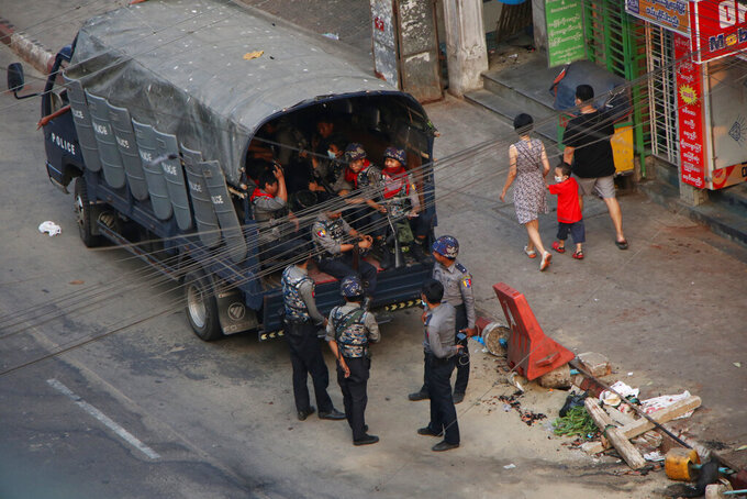 Security forces stand by on Hledan road in Kamayut township of Yangon in Myanmar, Monday, March 29, 2021. Over 100 people across the country were killed by security forces on Saturday alone, including several children. Myanmar aircraft also carried out three strikes along the country's border overnight Sunday, according to a member of the Free Burma Rangers, a humanitarian relief agency that delivers medical and other assistance to villagers. (AP Photo)