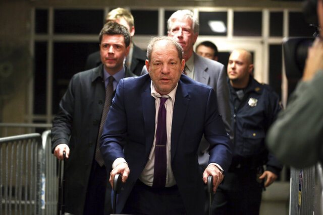 Harvey Weinstein, center, exits following his trial on charges of rape and sexual assault, Monday, Jan. 27, 2020, in New York. (AP Photo/Michael Owens)