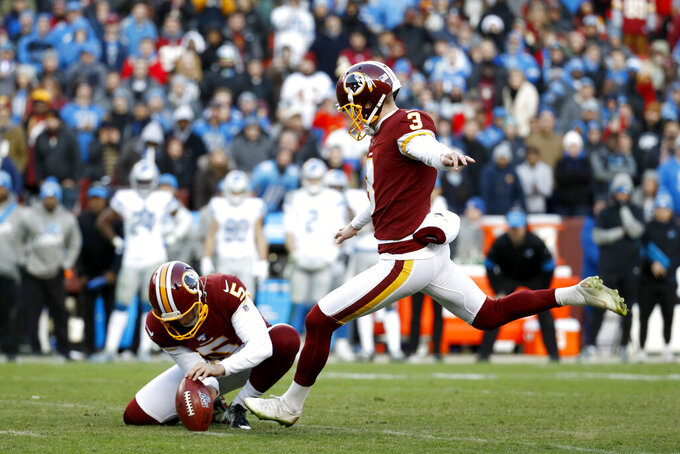 Washington Redskins kicker Dustin Hopkins, right, with Tress Way holding, kicks the eventual game-winning field goal in the final seconds of the second half of an NFL football game against the Detroit Lions, Sunday, Nov. 24, 2019, in Landover, Md. The Redskins won 19-16. (AP Photo/Patrick Semansky)