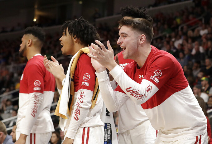 Wisconsin players cheer from the bench during the second half of a first round men's college basketball game against Oregon in the NCAA Tournament, Friday, March 22, 2019, in San Jose, Calif. (AP Photo/Chris Carlson)