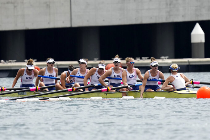 Jessica Thoennes, Charlotte Buck, Gia Doonan, Brooke Mooney, Olivia Coffey, Regina Salmons, Meghan Musnicki, Kristine O'Brien and Katelin Guregian of the United States react after competing in the women's rowing eight final at the 2020 Summer Olympics, Friday, July 30, 2021, in Tokyo, Japan. (AP Photo/Lee Jin-man)