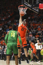 Oregon State's Gligorije Rakocevic dunks in front of Oregon's Kenny Wooten (14) during the first half of an NCAA college basketball game in Corvallis, Ore., Saturday, Feb. 16, 2019. (AP Photo/Amanda Loman)