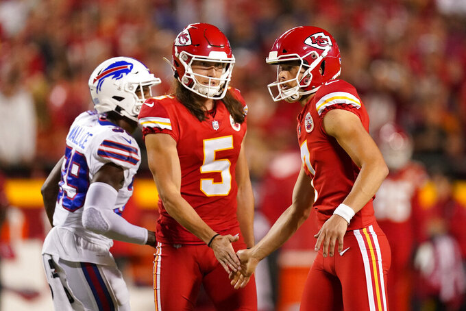 Kansas City Chiefs place kicker Harrison Butker, right, is congratulated by Tommy Townsend (5) after kicking a field goal during the first half of an NFL football game against the Buffalo Bills Sunday, Oct. 10, 2021, in Kansas City, Mo. (AP Photo/Charlie Riedel)