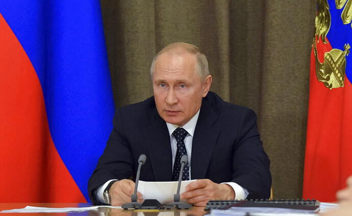 Russian President Vladimir Putin chairs a meeting of Russian military aviation in the Black Sea resort of Sochi, Russia, Wednesday, May 15, 2019. (Alexei Druzhinin, Sputnik, Kremlin Pool Photo via AP)