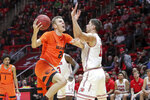 Oregon State forward Kylor Kelley (24) protects the ball from Utah forward Both Gach (11) during the first half of an NCAA college basketball game Saturday, Feb. 2, 2019, in Salt Lake City. (AP Photo/Chris Nicoll)