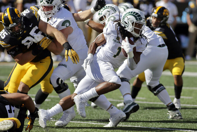 Colorado State running back A'Jon Vivens (1) runs with the ball during the first half of an NCAA college football game against Iowa, Saturday, Sept. 25, 2021, in Iowa City, Iowa. (AP Photo/Ron Johnson)