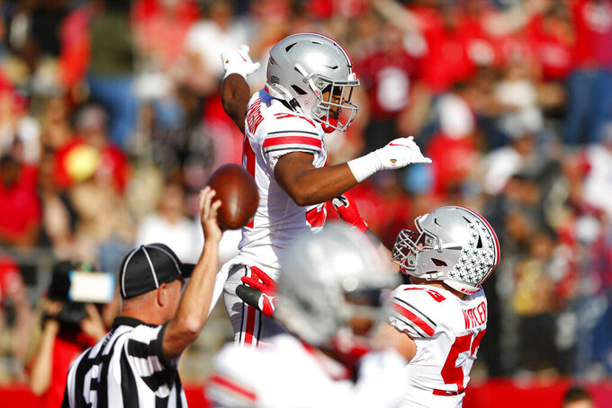 Ohio State running back TreVeyon Henderson (32) celebrates after scoring a touchdown against Rutgers during an NCAA college football game, Saturday, Oct. 2, 2021, in Piscataway, N.J. (AP Photo/Noah K. Murray)