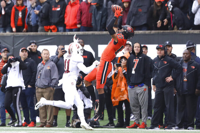Oregon State wide receiver Isaiah Hodgins (17) catches a pass from quarterback Jake Luton over Stanford cornerback Paulson Adebo (11) during the first half of an NCAA college football game in Corvallis, Ore., Saturday, Sept. 28, 2019. (AP Photo/Amanda Loman)