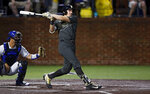 FILE - In this June 7, 2019, file photo, Vanderbilt's JJ Bleday follows through on a hit during the second inning of the team's NCAA college super regional baseball game against Duke, in Nashville, Tenn. The College World Series has an even stronger Southeastern Conference flavor than usual. Vanderbilt is the No. 2 national seed and led all schools with 13 draft picks, including first baseman and SEC player of the year JJ Bleday, who went fourth overall to the Miami Marlins.(AP Photo/Wade Payne, File)