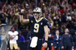 New Orleans Saints quarterback Drew Brees (9) reacts after throwing a touchdown pass to Michael Thomas in the second half an NFL football game against the San Francisco 49ers in New Orleans, Sunday, Dec. 8, 2019. (AP Photo/Butch Dill)