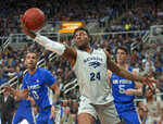 Nevada forward Jordan Caroline (24) grabs a rebound against Air Force in the first half of an NCAA college basketball game in Reno, Nev., Saturday, Jan. 19, 2019. (AP Photo/Tom R. Smedes)