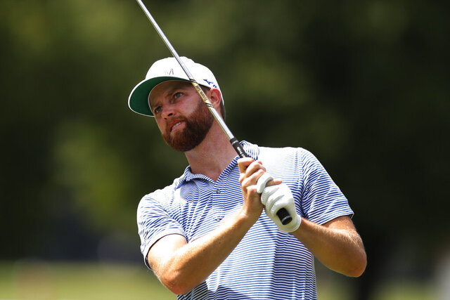Chris Kirk drives on the 15th tee during the second round of the Rocket Mortgage Classic golf tournament, Friday, July 3, 2020, at the Detroit Golf Club in Detroit. (AP Photo/Carlos Osorio)
