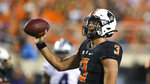 Oklahoma State quarterback Spencer Sanders (3) tosses the ball to an official during the first half of an NCAA college football game against Kansas State, Saturday, Sept. 25, 2021, in Stillwater, Okla. (AP Photo/Brody Schmidt)