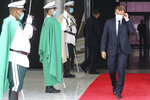 French President Emmanuel Macron, right, wears a face mask as he walks past a guard of honor upon arrival at Nouakchott Oumtounsy International Airport Tuesday June 30, 2020, in Nouakchott, to attend a G5 Sahel summit. Leaders from the five countries of West Africa's Sahel region, Burkina Faso, Chad, Mali, Mauritania and Niger, meet with French President Emmanuel Macron and Spanish Prime Minister Pedro Sanchez in Mauritania's capital Nouakchott on Tuesday to discuss military operations against Islamic extremists in the region, as jihadist attacks mount. The five African countries, known as the G5, have formed a joint military force that is working with France, which has thousands of troops to battle the extremists in the Sahel, the region south of the Sahara Desert. (Ludovic Marin, Pool via AP)