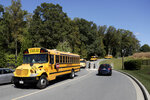 School buses leave the McDonogh School campus after a reported explosion, Wednesday, Sept. 18, 2019, in Owings Mills, Md. An explosion in the boiler room at the school injured a child and two adults, according to reports. (AP Photo/Julio Cortez)