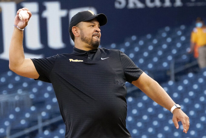 Pittsburgh basketball coach Jeff Capel throws out a ceremonial first pitch before a baseball game between the Pittsburgh Pirates and the St. Louis Cardinals, Thursday, Aug. 26, 2021, in Pittsburgh. (AP Photo/Keith Srakocic)