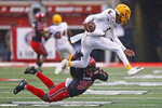 Utah linebacker Devin Lloyd (20) tackles Arizona State quarterback Jayden Daniels (5) during the first half of an NCAA college football game Saturday, Oct. 19, 2019, in Salt Lake City. (AP Photo/Rick Bowmer)