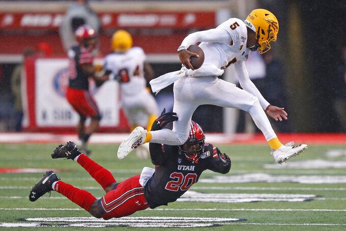 Utah linebacker Devin Lloyd (20) tackles Arizona State quarterback Jayden Daniels (5) during the first half of an NCAA college football game Saturday, Oct. 19, 2019, in Salt Lake City. (AP Photo/Rick Bowmer)