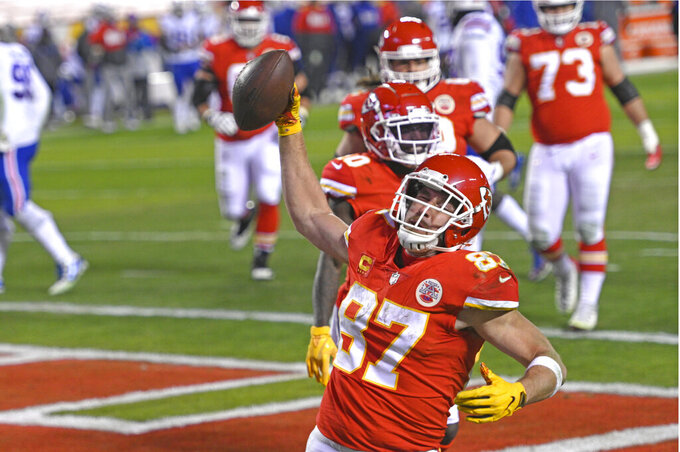 Kansas City Chiefs tight end Travis Kelce celebrates after catching a 5-yard touchdown pass during the second half of the AFC championship NFL football game against the Buffalo Bills, Sunday, Jan. 24, 2021, in Kansas City, Mo. (AP Photo/Reed Hoffmann)