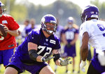 FILE - In this Friday, July 28, 2017 file photo, Minnesota Vikings tackle Mike Remmers (72) protects quarterback Sam Bradford (8) from defensive end Danielle Hunter (99) during NFL football training camp in Mankato, Minn. The Minnesota Vikings have released right guard Mike Remmers and declined an option on safety Andrew Sendejo's contract, clearing more than $10 million in space under their salary cap. The moves were made Monday, March 11, 2019 when NFL teams could begin negotiating deals with players eligible for unrestricted free agency on Wednesday.(AP Photo/Andy Clayton-King, File)