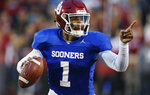 Oklahoma quarterback Jalen Hurts gestures during the NCAA college football team's spring game in Norman, Okla., Friday, April 12, 2019. (AP Photo/Sue Ogrocki)