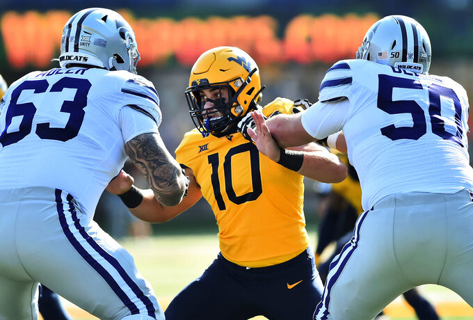 West Virginia  linebacker Dylan Tonkery (10) is blocked by Kansas State defensive end Tyrone Taleni (50) during an NCAA college football game Saturday, Oct. 31, 2020, in Morgantown, W.Va. (William Wotring/The Dominion-Post via AP)