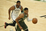 Milwaukee Bucks' Giannis Antetokounmpo drives past Brooklyn Nets' Bruce Brown during the first half of Game 3 of the NBA Eastern Conference basketball semifinals game Thursday, June 10, 2021, in Milwaukee. (AP Photo/Morry Gash)