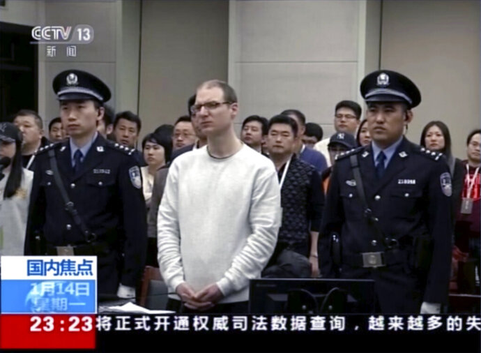 FILE - In this file image taken from Jan. 14, 2019, video footage run by China's CCTV, Canadian Robert Lloyd Schellenberg attends his retrial at the Dalian Intermediate People's Court in Dalian, northeastern China's Liaoning province. A Chinese court has held an appeal hearing Thursday, May 9, 2019, for the Canadian who was sentenced to death for drug smuggling. No decision was immediately announced after the hearing. (CCTV via AP, File)
