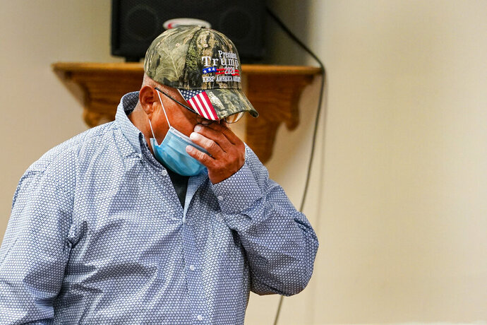 Daniel Lee, father of Tiffany Lee, wipes his face as he leaves the podium after a statement by his attorney at the federal prison complex in Terre Haute, Ind., Wednesday, Aug. 26, 2020. Lezmond Mitchell, the only Native American on federal death row, was executed at 6:29 p.m. for the slaying of Lee's 9-year-old daughter Tiffany and her grandmother nearly two decades ago. (AP Photo/Michael Conroy)