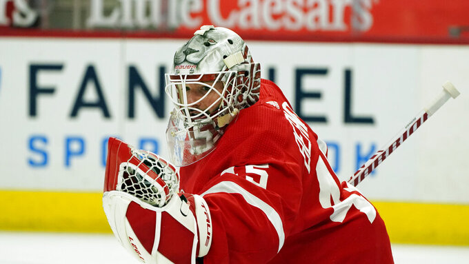 FILE - In this Thursday, March 18, 2021 file photo, Detroit Red Wings goaltender Jonathan Bernier plays during the first period of an NHL hockey game, in Detroit.  Bernier could be the best goaltender on the move at the trade deadline, even though he hasn't played since March 18 because of injury.  (AP Photo/Carlos Osorio, File)