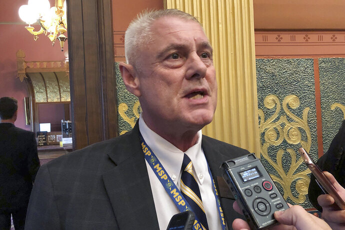 FILE - in this Sept. 3, 2019 file photo State Rep. Larry Inman, R-Williamsburg, speaks with reporters in the House chamber in Lansing, Mich. The trial of state Rep. Inman, from the Traverse City area who is facing federal charges in an alleged scheme to trade votes for campaign cash, will begin Tuesday, Dec. 3, 2019, in Grand Rapids, Mich. (AP Photo/David Eggert File)