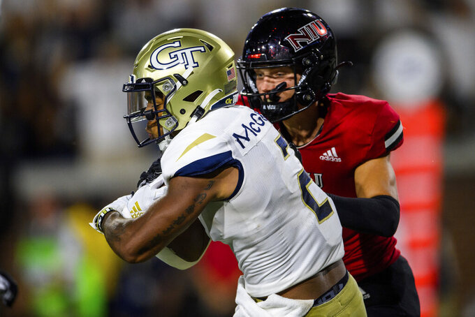Georgia Tech wide receiver Kyric McGowan (2) scores a touchdown as Northern Illinois safety Jordan Hansen (7) defends during the first half of an NCAA college football game, Saturday, Sept. 4, 2021, in Atlanta. (AP Photo/Danny Karnik)