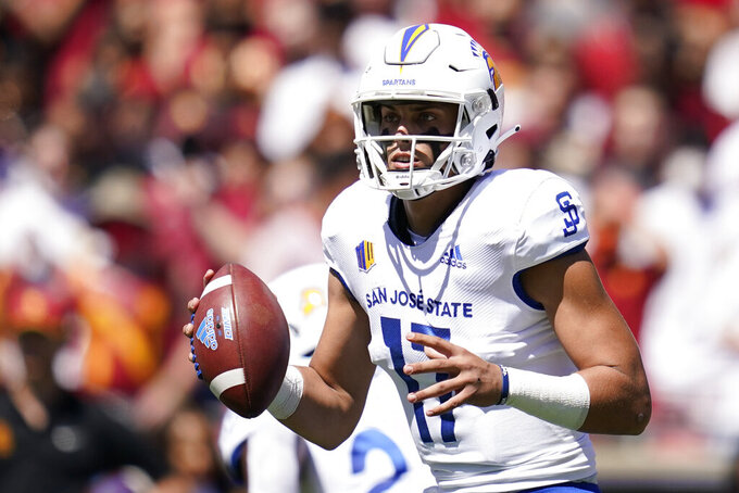 San Jose State quarterback Nick Starkel (17) looks for a receiver during the first half of an NCAA college football game against Southern California Saturday, Sept. 4, 2021, in Los Angeles. (AP Photo/Ashley Landis)