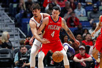 New Orleans Pelicans guard JJ Redick (4) and Phoenix Suns forward Dario Saric watch the ball during the first half of an NBA basketball game in New Orleans, Thursday, Dec. 5, 2019. (AP Photo/Gerald Herbert)