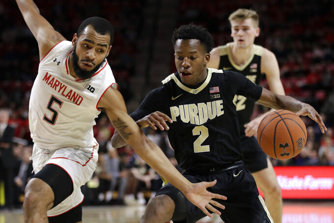 Maryland guard Eric Ayala, left, reaches for possession of the ball from Purdue guard Eric Hunter Jr. during the first half of an NCAA college basketball game Tuesday, Feb. 12, 2019, in College Park, Md. (AP Photo/Patrick Semansky)