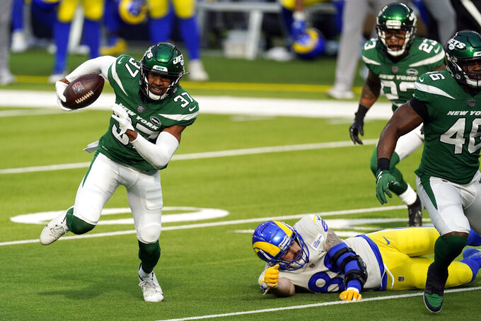 New York Jets cornerback Bryce Hall (37) runs back with an intercepted pass during the first half of an NFL football game against the Los Angeles Rams Sunday, Dec. 20, 2020, in Inglewood, Calif. (AP Photo/Ashley Landis)